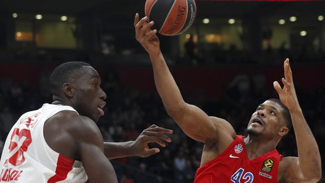 CSKA Moscow's Kyle Hines, right, tries to score as Red Star's Michael Ojo block him during their Euroleague basketball match on Feb. 21 in Belgrade, Serbia. Ojo, a former Florida State center, has died after collapsing during training in Serbia. Serbian Media and his former teammates say the 27-year-old Nigerian-born basketball player was on Friday taken to a hospital in the Serbian capital, but doctors failed to revive him.