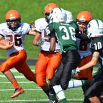 Enzo Rodriguez (26) of the Northville Stallions tries to find a seam against the Novi defense.