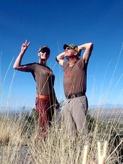Anna and Rich Dozier take a break while hiking in matching