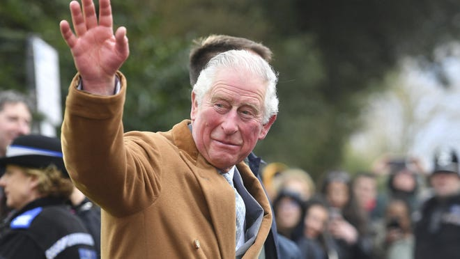 Britain's Prince Charles, greets members of the public as he leaves the RSC or Royal Shakespeare Company, in Stratford-upon-Avon, England, on Feb. 18 during his tour of Warwickshire and the West Midlands.