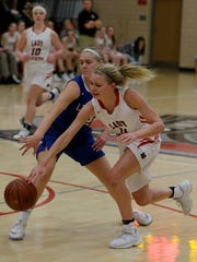 Lourdes Academy's Alexis Rolph tries to get around St. Mary's Springs Gracie Rieder during their game.  Lourdes Lady Knights hosted St. Mary's Springs Academy Tuesday, December 5, 2017 in girls basketball.  Joe Sienkiewicz / USA TODAY NETWORK-Wisconsin