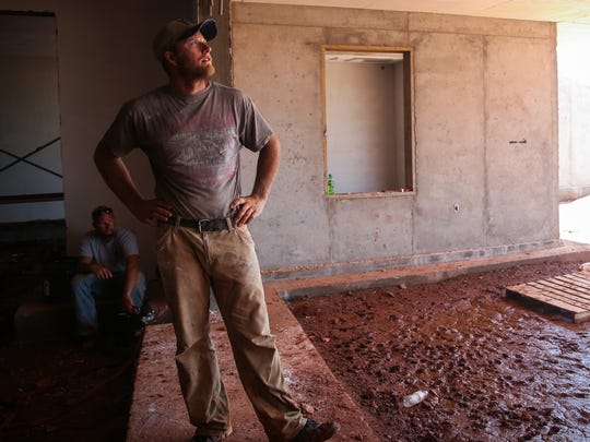 Cameron Scafe, Earth Sheltered foreman, walks around the construction of an underground home June 16, 2016, in Coke County.