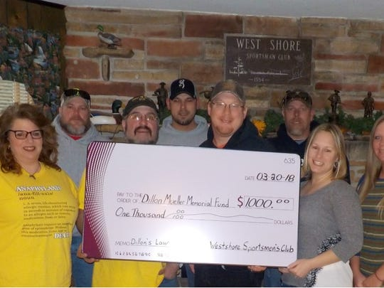 Westshore Sportsman's Club's Winter Washer Open raised $1,000 for Dillon's Law in February 2018. Pictured, front row, from left:Dillon's parents,Angel and George Mueller; Westshore Sportsman's ClubPresidentMike Krizizke; and event committee membersStacy Frenz andKrystal Hasselman; and back row, from left: Jason Frasch, Cory Kozlowski andJoey Kulpa.