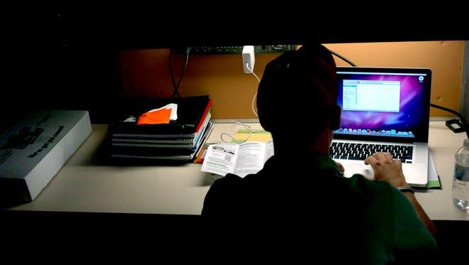 Students attending cyber charter schools complete coursework online.