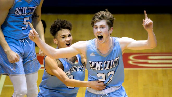 Boone County guard Parker Kyle (right) reacts to his game-winning shot at the buzzer against Conner at Conner High School, Hebron, KY, Friday Jan. 26, 2018