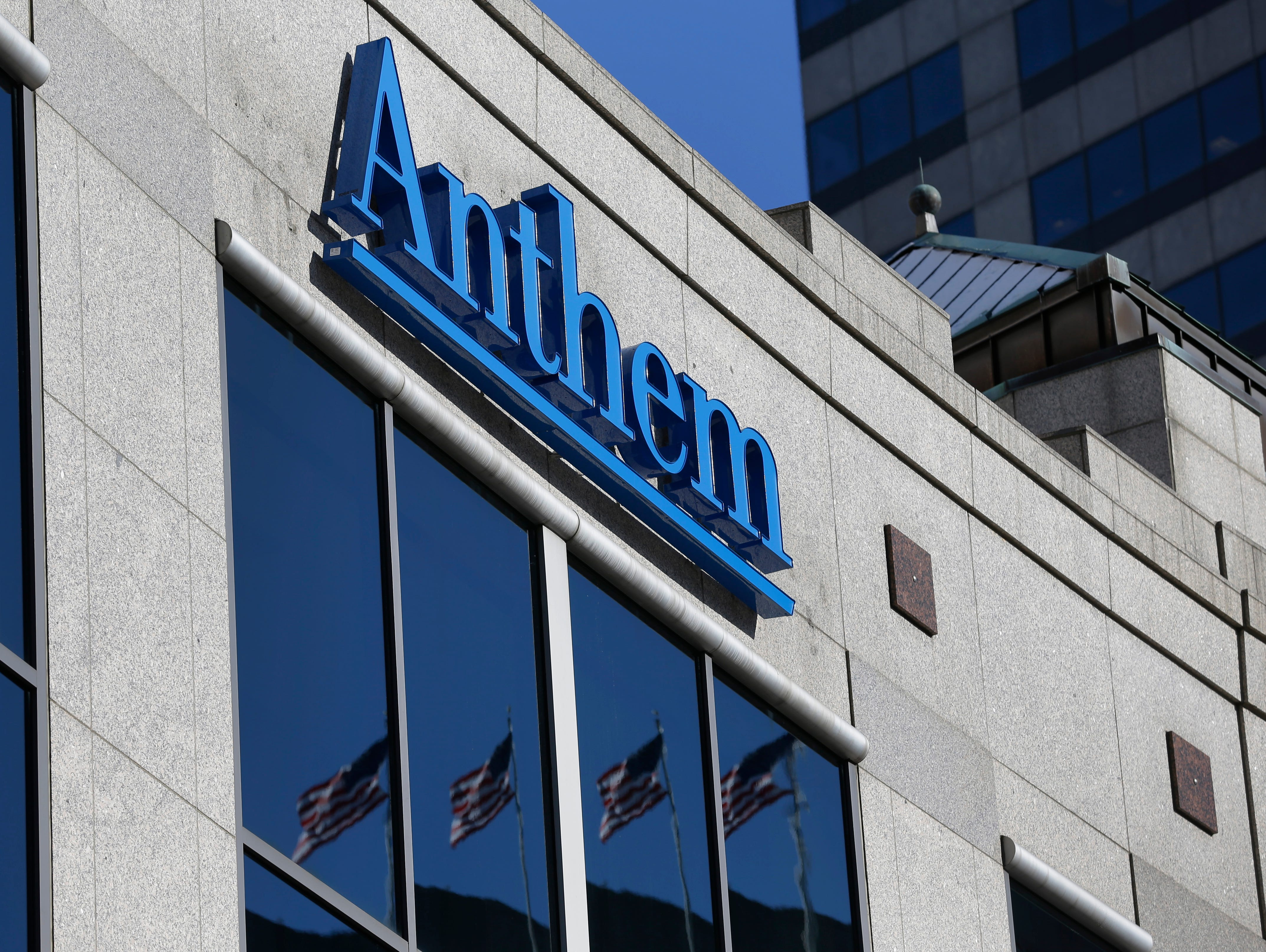 The Anthem logo hangs at the health insurer's corporate headquarters in Indianapolis Thursday, Feb. 5, 2015. Hackers broke into the company's database storing information for about 80 million people in an attack bound to stoke fears many Americans ha