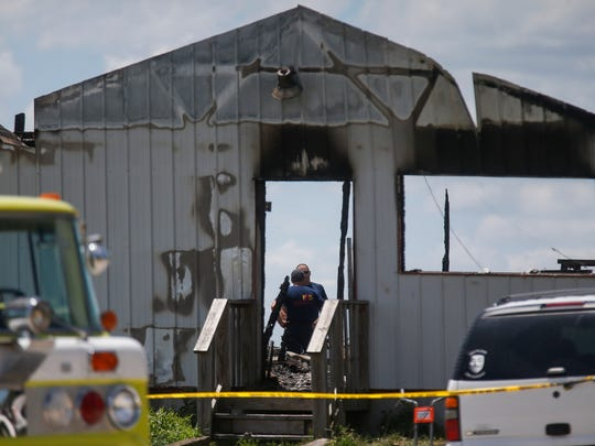 The fire marshal, firefighters and members of the Bureau of Alcohol, Tobacco, Firearms and Explosives investigate the scene of an explosion and fire that occurred Tuesday, July 3, 2018 at AM Pyrotechnics in Polk County.