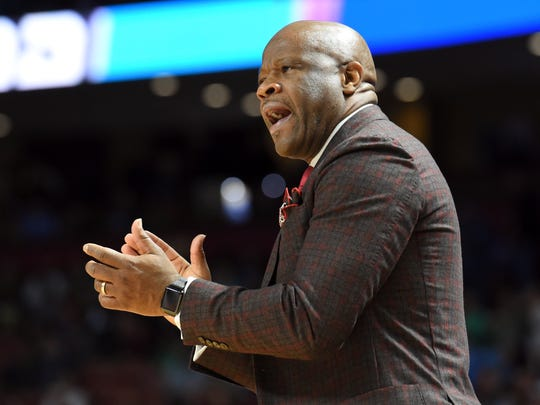 Arkansas head coach Mike Anderson applauds his team against Seton Hall during the first half in a first-round game of the NCAA men's college basketball tournament in Greenville, S.C., Friday, March 17, 2017. (AP Photo/Rainier Ehrhardt)