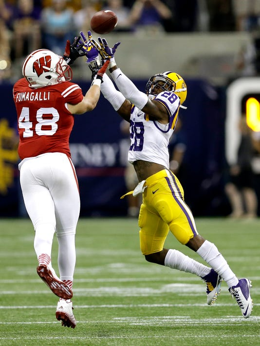 APTOPIX LSU Wisconsin_Foot.jpg
