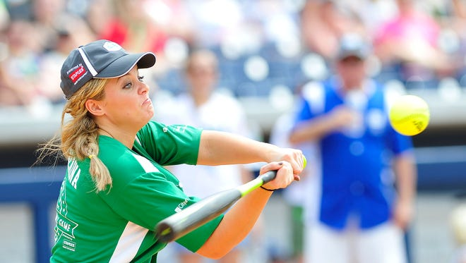 Lauren Alaina swings during the City of Hope celebrity softball game at First Tennessee Park in Nashville, Tenn. June 13, 2015.