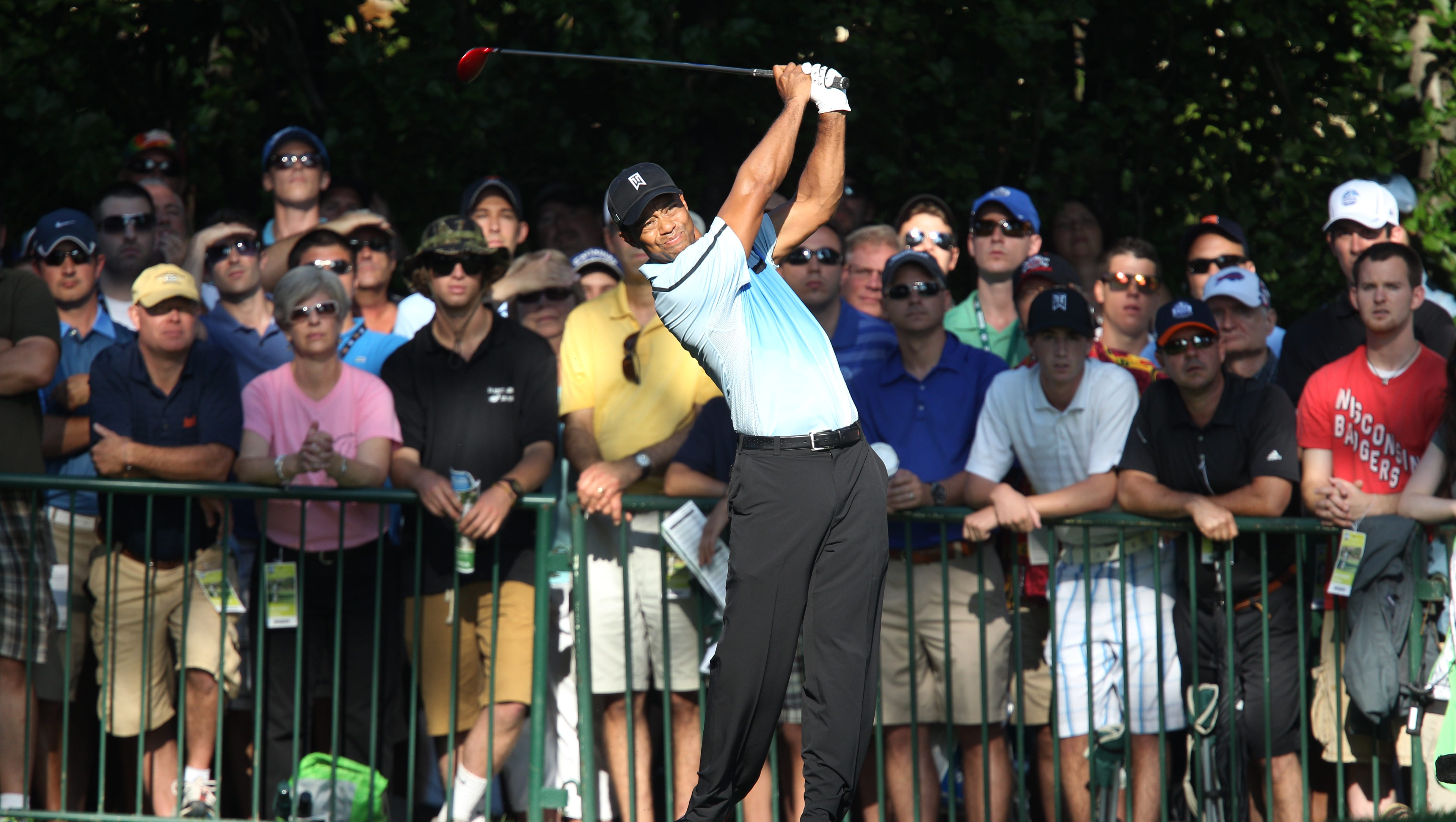 Tiger Woods tees off 10.