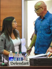 In this Jan. 17 file photo, Ana Kristine Absalon, left, speaks with her attorney after appearing at the Superior Court of Guam in Hagåtña. Absalon this week entered a plea agreement in a related federal case.