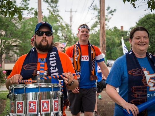 Joseph Hollon, 35, of Anderson Twp., plays the snare as he and members of Die Innenstadt march from Mecklenburg Gardens to Nippert Stadium before the FC game against the Richmond Kickers on June 4.