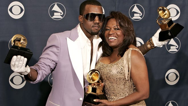 Kanye West, with awards for Best Rap Song, Best Rap Solo Performance and Best Rap Album, poses with his mother Donda West in the press room at the 48th Annual Grammy Awards at the Staples Center on February 8, 2006 in Los Angeles, California.