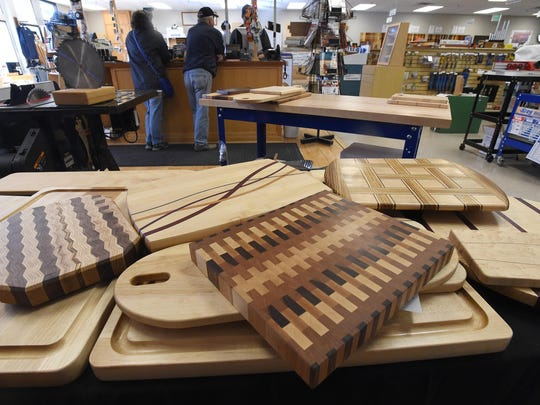 Some of the signature boards made by Sears Trostel employees auctioned at last year's Bread N Boards fundraiser.