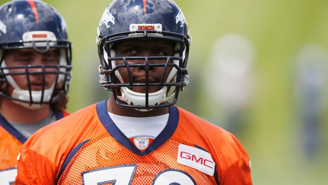 Denver Broncos tackle Ryan Clady waits to take part in drills May 27, 2015.
