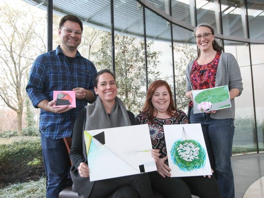 Artists (from left) Scott Stulen, Emily Kennerk, Kate Oberreich and Rebecca King pose with creations made during a promotional exercise for the Monster Drawing Rally at the Indianapolis Museum of Art.