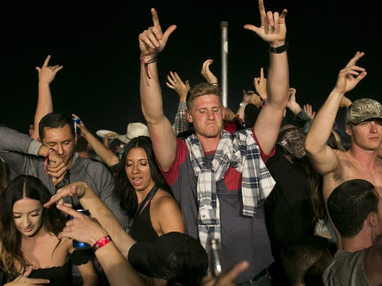 Festivalgoers party and dance at Country Thunder Arizona Music Festival in the early hours of Saturday, April 7, 2018, in Florence, Arizona.