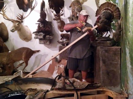 Ty Snider, Tuscarora Wildlife Education Project board member, dismantles a wetland display.