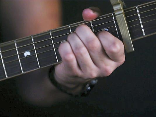 Singer Tom Senseney plays guitar on June 4.