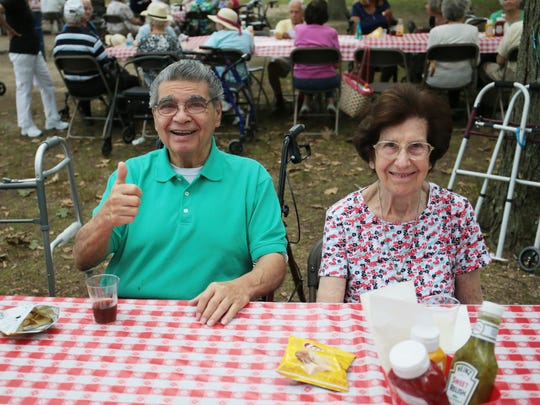 Residents from several Chelsea Senior Living locations in New Jersey attended a picnic at Thompson Park in Jamesburg on July 13, 2016. Lenny Lo Mauro, left, and Virginia Donner wait for lunch to be served.