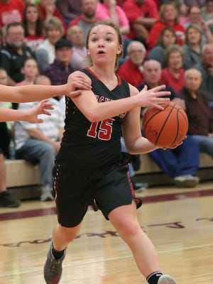 Buckeye Central's Taylor Ratliff moves the ball down the court during the district championship game.