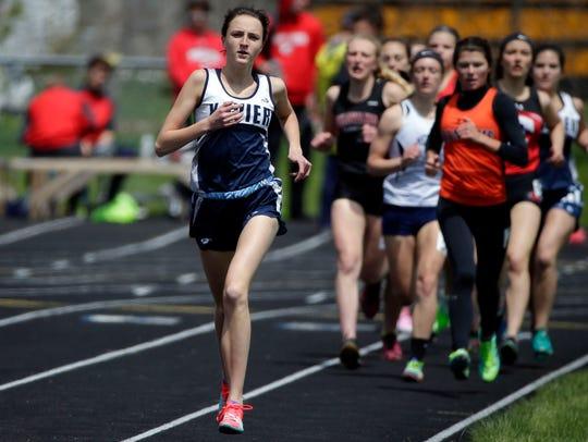 Annie Higgins of Xavier leads the 1,600-meter run at