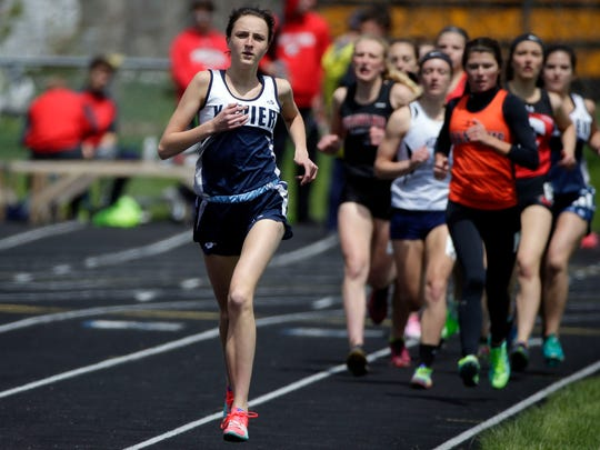Annie Higgins of Xavier leads the 1,600-meter run at