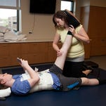Connor Walsh works on rehabilitation at Craig Hospital in Englewood. The Poudre High School teen was struck by a hit-and-run driver earlier this year.