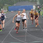 Ankeny Centennial's Hannah Draayer takes a handoff from Karri Pippett in the distance medley relay during a Class 4-A regional meet last season at Urbandale. Draayer has verbally committed to South Dakota.