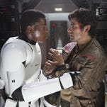 Finn and Poe Dameron probably haggling with each other on who Abrams should off first.