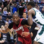 Heat guard Dwyane Wade, left, drives to the basket against Bucks guard Khris Middleton during a game in January.