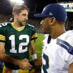 Packers quarterback Aaron Rodgers and Seahawks quarterback Russell Wilson meet after Green Bay's victory last season.