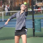 Ankeny Centennial's Michelle Nitschke serves the ball during a dual meet at Urbandale on April 13. The Jaguars suffered a 10-1 loss.