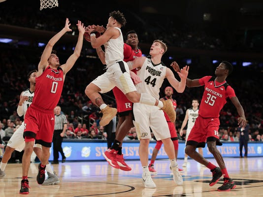 Purdue guard Carsen Edwards (3) goes up for a shot against Rutgers guard Geo Baker (0) during the second half of an NCAA Big Ten Conference tournament college basketball game, Friday, March 2, 2018, in New York. Purdue won 82-75. (AP Photo/Julie Jacobson)