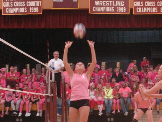 Luxemburg-Casco senior Alecia Cherney sets the ball for freshman Alexis Dorner during the 2014 Pink Out match against West De Pere.