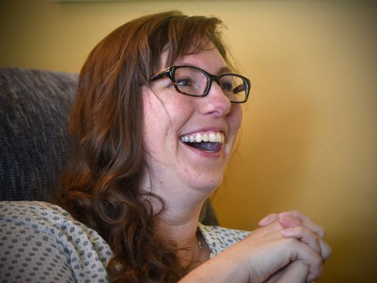 Artist Zoe Back smiles during an interview Tuesday,