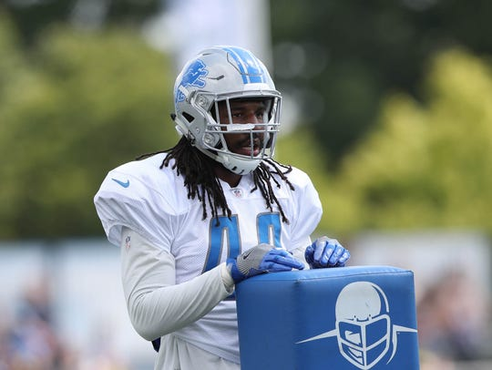 Lions linebacker Jalen Reeves-Maybin watches drills