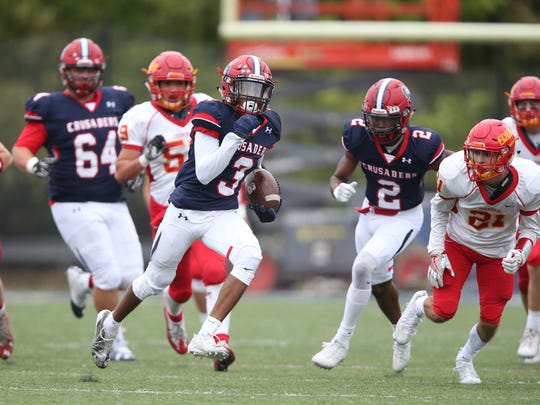 Stepinac's Shawn Harris (3) breaks free to score a touchdown during their 34-7 win over Chaminade in CHSFL 'AAA' football action at Archbishop Stepinac High School in White Plains on Saturday, September 30, 2017.