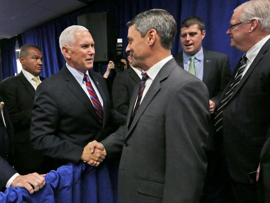 People greet Vice President Mike Pence after the Infosys