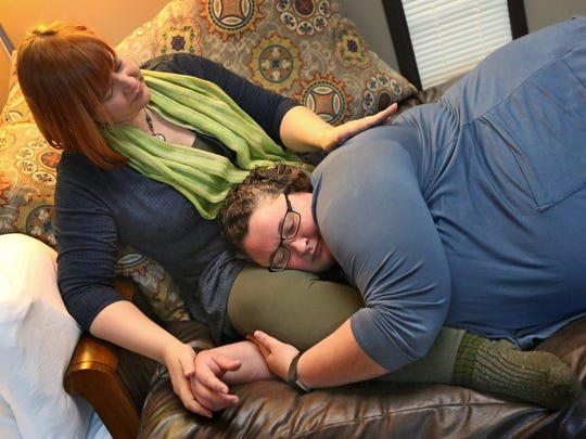 Lisa Meece, left, snuggles with her client Charity