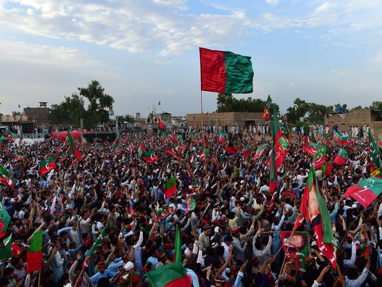 Supporters of Pakistani cricketer-turned-politician Imran Khan, head of the Pakistan Tehreek-i-Insaf (PTI) party, attend a campaign rally in Charsadda District in the Khyber Pakhtunkhwa province on July 5, 2018.