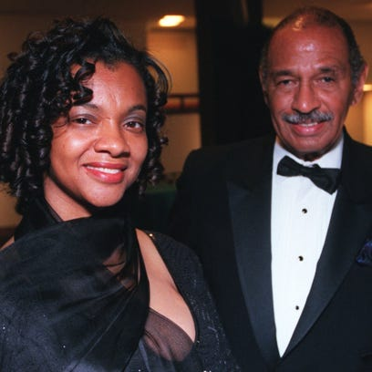 Monica and John Conyers in a 2001 file photo.