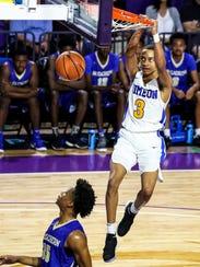 Simeon's Xavier Pinson dunks. Simeon played McEachern