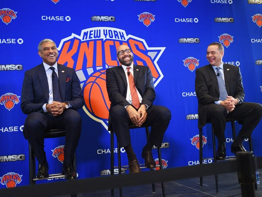 Knicks new head coach David Fizdale (C) shares a laugh with Steve Mills (L),President and Scott Perry (R), General Manager during a press conference at Madison Square Garden in New York  on 05/08/18.