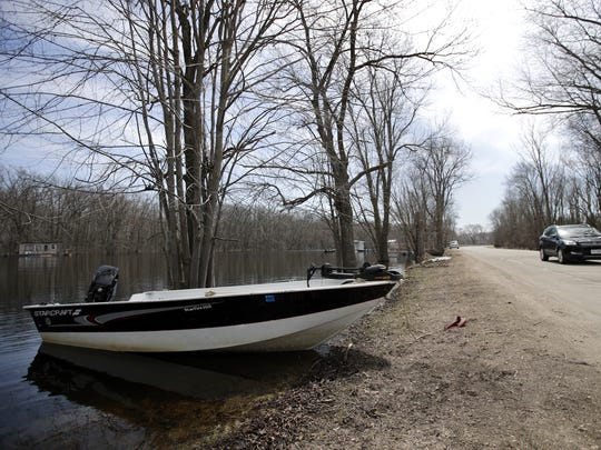 A boat is docked Monday close to the West Wolf River Avenue because of the high water along the Wolf River Mukwa.