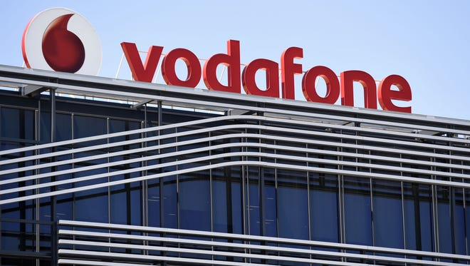 The logo of British telecom giant Vodafone atop the Spanish headquarters in Madrid.