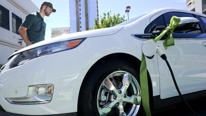 In 2013: Sean Sullivan examines a Chevrolet Volt during the unveiling of charging stations at Harrah's Reno.