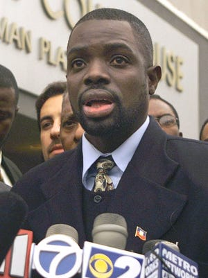Abner Louima, the Haitian immigrant assaulted by former New York City Police officer Justin Volpe, speaks to reporters after Volpe's sentencing in U.S. District Court in the Brooklyn borough of New York, Monday, Dec. 13, 1999. The white former patrolman was sentenced to 30 years in prison Monday, Dec. 13, for an assault on the Black immigrant that prosecutors called one of the worst acts of police brutality in city history.