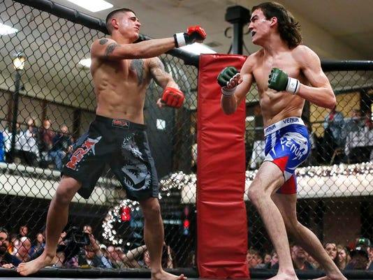 -Cage Fight 4.jpg_20140125.jpg